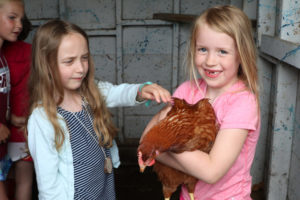 kids holding a chicken