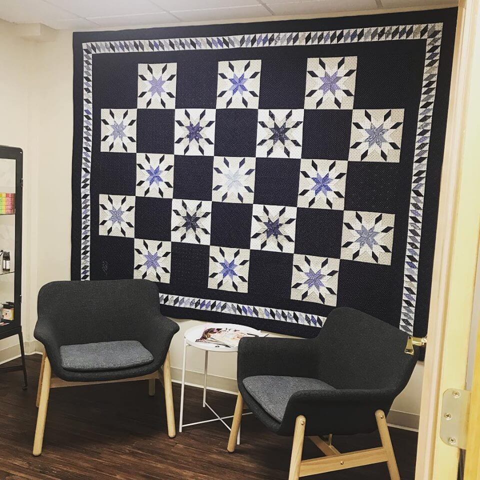 black and white quilt on a wall