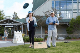 two people playing corn hole