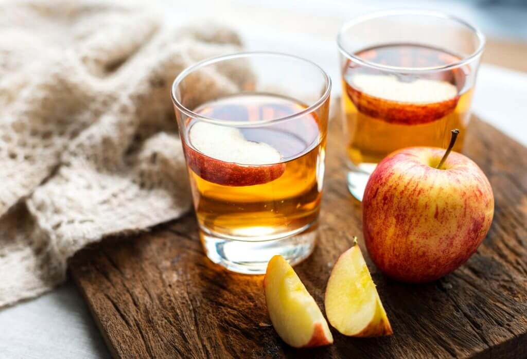 two glasses of apple cider